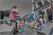 Day Tripper - Paris is a  selective colour street photography series by photographer Paul Williams of tourists enjoying a sunny day visit to Paris taken on 15th July 2007.