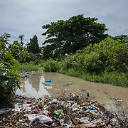 A contaminated river that flows through the Los Calzones community in San Juan De La Maguana Province of the Dominican Republic, September 13, 2017. The river is the only source of water for mot of the community, and overflowed its banks when Hurricane Irma hit. It became more contaminated than usual. The pollution levels did cause the government to close the pipe flows from it to the community for seven days following the hurricane. The area is prone to diseases such as mosquitos, increasing cases of dengue, chikungunya, zika and others.