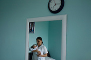 """Latin American Immigrants in Barcelona.<br /> Galdis from Ecuador is holding his firts born son in his arms in his beth room. She and her housband Darwin came to Barcelona in 2000 and both started to work without legal permissions. Darwin was working within the construction sector and Gladis was cleaning houses. They had to live in clandestinity for more then a year until the government decided to start a program to regulate all """"illegal"""" immigrants in the country. After having achieved their papers, Darwin and Gladis were able to rent an apartment and get full-time work contracts. They decided to have a child and gave him a catalan name, Joan. In 2008, the Spanish government reveal that the birthrate in all the country was increasing thanks of the immigration."""