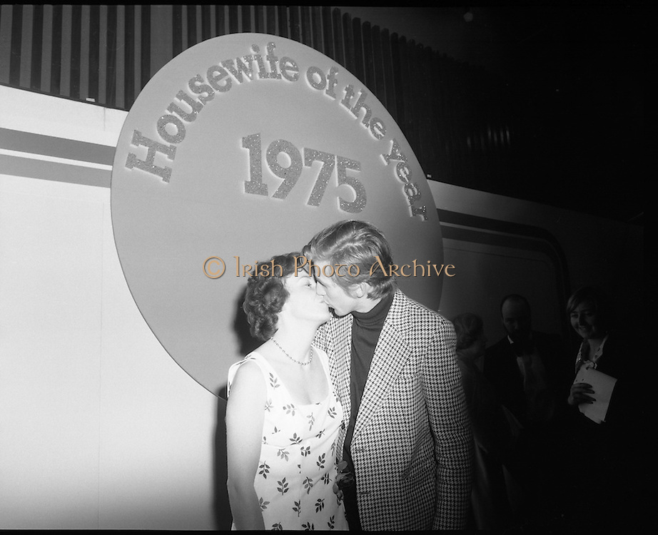 Housewife Of The Year Final.        (J91).1975..25.11.1975..11.25.1975..25th November 1975..The Housewife Of The Year Final took place today at Jury,s Hotel,Ballsbridge,Dublin. The event was sponsored by Mc Donnells, Calor/Kosangas and Woman's Way magazine. The show was compered by Mr Mike Murphy from RTE..The finalists were:.Mrs Geraldine Cronin,Nenagh,Co Tipperary..Mrs Deirdre Dolan,Passage West,Co Cork..Mrs Barbara Hartigan,Castleconnell,Co Limerick..Mrs Frances Twomey,Castlebar, Co Mayo..Mrs Susanne Browne,Lifford, Co Donegal..Mrs Lilian Murphy, Dunshaughlin,Co Meath..Mrs Eileen Jones,Donabate, Co Dublin..The sevenfinalists were selected from a group of eighty four entrants.The cookery section was judged by Paula Daly,McDonnell's Good Food Kitchen,Liz Boyhan,Calor Kosangas and Honor Moore, Woman's Way..Image of Mr Leslie Hartigan sealing Mrs Barbara Hartigan win with a loving kiss.
