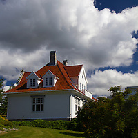 Europe, Norway, Molde. A home in Molde, wood with tile roof.