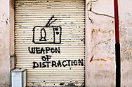 Beirut, Lebanon - September 26, 2010: Graffiti critical of television on a shuttered shop in Beirut.
