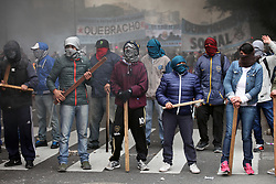 June 28, 2017 - Buenos Aires, Argentina - Protestors in masks holding wood sticks block a street. Serious clashes between Police and Social Organizations protesting against the government's economic policies. (Credit Image: © Claudio Santisteban via ZUMA Wire)