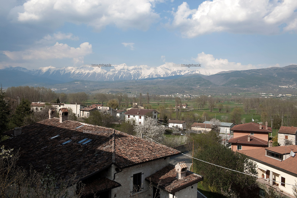 On April the 6th 2009 at  3.32 a.m, a powerful earthquake struck a huge part of the Abruzzo region of central Italy killing 295 people. The dead were mainly in L'Aquila, a 13th century mountain city about 100 miles east of Rome that has a population of 80,000, and surrounding villages. This photodocumentary follows life in a small village outside L'Aqulia that lost 1/3 of its population in the quake. Onna was completely destroyed by the quake, and left the every  single citizen to live in army tents outside the village. Photo: Christopher Olssøn