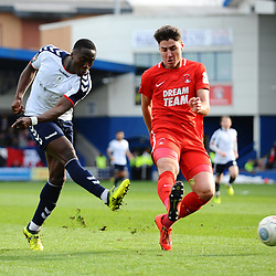 TELFORD COPYRIGHT MIKE SHERIDAN 23/3/2019 - Dan Udoh of AFC Telford shoots under pressure from Dan Happe of Orient during the FA Trophy Semi Final fixture between AFC Telford United and Leyton Orient at the New Bucks Head