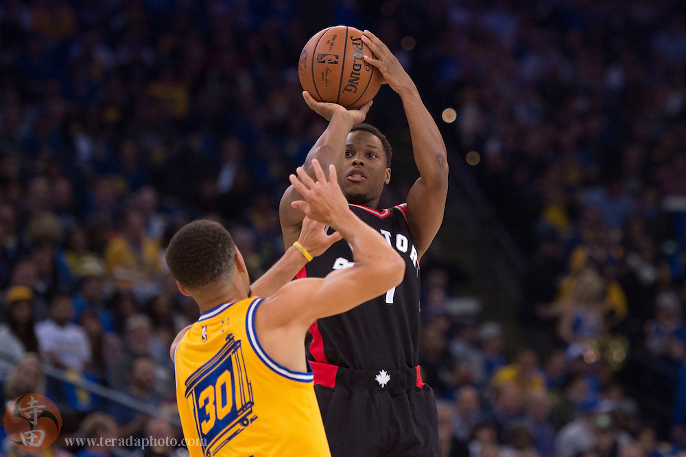 November 17, 2015; Oakland, CA, USA; Toronto Raptors guard Kyle Lowry (7) shoots the basketball against Golden State Warriors guard Stephen Curry (30) during the first quarter at Oracle Arena.