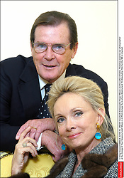 © Greg Soussan/ABACA. 42159-19. UNICEF Goodwill Ambassador Roger Moore and his wife Christina Tholstrup pose for our photographerat the George V Four Seasons hotel. Moore is in Paris to tape the tv show Absolument 70 (Absolutely 70's) for the M6 tv channel.