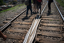 Honduran migrants walk the rail tracks their way to stow away between carriages on a freight train known to many as La Bestia. Apizaco, Mexico.