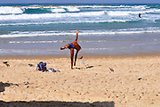 Israel, Tel Aviv, a person stretching on the beach