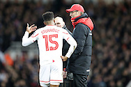 Daniel Sturridge of Liverpool talking to Jürgen Klopp, the Liverpool manager from the touchline during an injury break in normal time. The Emirates FA cup, 4th round replay match, West Ham Utd v Liverpool at the Boleyn Ground, Upton Park  in London on Tuesday 9th February 2016.<br /> pic by John Patrick Fletcher, Andrew Orchard sports photography.