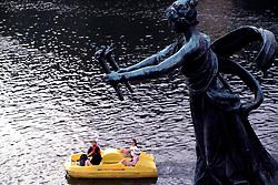 CZECH REPUBLIC BOHEMIA PRAGUE JUL97 -  A statue on Cechuv Most holds torches for tourists floating on the river Vltava below. ..jre/Photo by Jiri Rezac. . © Jiri Rezac 1997. . Tel:   +44 (0) 7050 110 417. Email: jiri@jirirezac.com. Web:   www.jirirezac.com