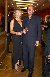 VISCOUNT & VISCOUNTESS DAVENTRY at '4 Inches' a project 'For Women about Women By Women' - A photographic Auction in aid of the Elton John Aids Foundation hosted by Tamara Mellon President of Jimmy Choo and Arnaud Bamberger MD of Cartier UK at Christie's, 8 King Street, London W1 on 25th May 2005.<br /><br />NON EXCLUSIVE - WORLD RIGHTS