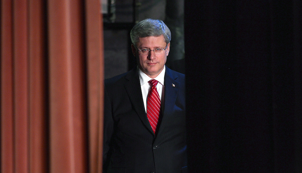 Prime Minister Stephen Harper waits to come on stage to deliver remarks at the Ukrainian Observer Mission Training Session at the Canadian Museum of Civilization in Gatineau, Que., Friday, Oct.19, 2012. THE CANADIAN PRESS/Sean Kilpatrick