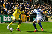 Deji Oshilaja (4) of AFC Wimbledon battles for possession with Michael Kelly (28) of Bristol Rovers during the EFL Sky Bet League 1 match between Bristol Rovers and AFC Wimbledon at the Memorial Stadium, Bristol, England on 23 October 2018.