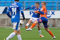Treningskamp fotball 2014: Molde - Aalesund. Aalesunds Jo Nymo Matland (t.h.) i duell med Mattias Moström i treningskampen mellom Molde og Aalesund på Aker stadion.