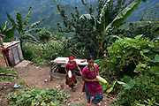 Women bringing some home grown gigantic cucumbers.The Chepangs is an ethnic group which used to be nomadic. Only recently have the settled and their settlements are high up in the mountains. Only a few years ago they did not have any running water and had to bring up water from below but with the help pf Restless Development and their partner NGO Prayash Nepal they now have running clean water from springs diverted into resovoirs and the connected to taps inther settlement. This not only give them clean water to drink, it also improve hygiene dramatiaclly and improve health and it saves precious time for the women who now spend the 4 hours it used to take getting water growing healhty vegetables.