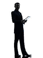 one  business man holding digital tablet posing in silhouette on white background