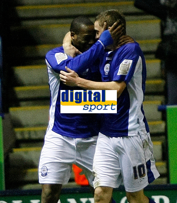 Photo: Steve Bond/Richard Lane Photography. Leicester City v Swansea City. FA Cup Third Round. 02/01/2010. Dany N'Guessan (L) is congratulated