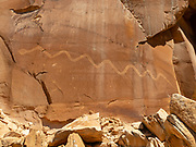 The Solstice Snake is an ancient archeoastronomy site near Moab, Utah. A shadow falls exactly on the snake's head on the summer solstice, marking the event for the ancient Anasazi who created this petroglyph hundreds of years ago.