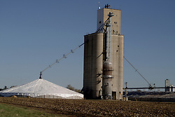 29 October 2006:  A good harvest has exceeded the available storage space. Temporary storage is built next to this elevator and the grain is covered with plastic tarps.  The grain will remain this way until it is bought and moved. LeRoy, Illinois.<br />