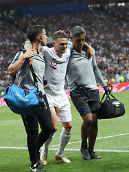 MOSCOW, July 11, 2018  Kieran Trippier (C) of England leaves the pitch after his injury during the 2018 FIFA World Cup semi-final match between England and Croatia in Moscow, Russia, July 11, 2018. Croatia won 2-1 and advanced to the final. (Credit Image: © Cao Can/Xinhua via ZUMA Wire)