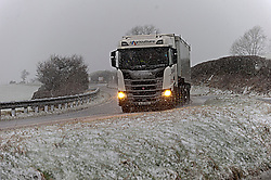 © Licensed to London News Pictures. 30/01/2021. Llanfihangel Nant Melan, Powys, Wales, UK. A truck drives through a blizzard on the A44 road near Llanfihangel nant Melan in Powys, Wales, UK. Photo credit: Graham M. Lawrence/LNP