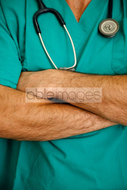 Close up of a doctor with arms crossed and stethoscope - headless