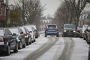 Vehicles pass each other on a minor road in the south London borough of Herne Hill, Lambeth during the bad weather covering every part of the UK and known as the 'Beast from the East' because Siberian winds and very low temperatures have blown across western Europe from Russia, on 1st March 2018, in Lambeth, London, England
