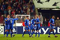 Photo: Scott Heavey.<br /> VFB Stuttgart v Chelsea. Champions League Quarter Final First Leg. 25/02/2004.<br /> The Chelsea team celebrate the 1-0 victory
