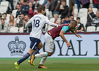 Football - 2017 / 2018 Premier League - West Ham United vs Tottenham Hotspur<br /> <br /> Fernando Llorente (Tottenham FC)  pushes over Winston Reid (West Ham United) in an attempt to reach the ball at the London Stadium<br /> <br /> COLORSPORT/DANIEL BEARHAM