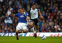 Photo: Alan Crowhurst.<br /> Portsmouth v Tottenham Hotspur. Barclaycard Premiership.<br /> 13/08/2005. Laurent Robert (l) is run off the ball by Spurs Paul Stalteri.
