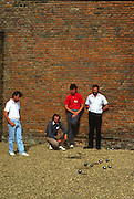 Osterley, Greater london.  Competitors study the positing of the Boules,  at the  Le Piat d'Or,  Petanque/Boules Championships held in the grounds of Osterley House West London, England, [Mandatory Credit; Peter Spurrier/Intersport Images] 19870912 Petanque Championships, Osterley, Greater London, UK