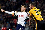 Christian Eriksen of Tottenham Hotspur (L) in action with Mark O'Brien of Newport County (R). The Emirates FA Cup, 4th round replay match, Tottenham Hotspur v Newport County at Wembley Stadium in London on Wednesday 7th February 2018.<br /> pic by Steffan Bowen, Andrew Orchard sports photography.