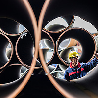 Dalton Industrial Est , Thirsk. Cleveland Steel Large steel tubes and pipes with worker