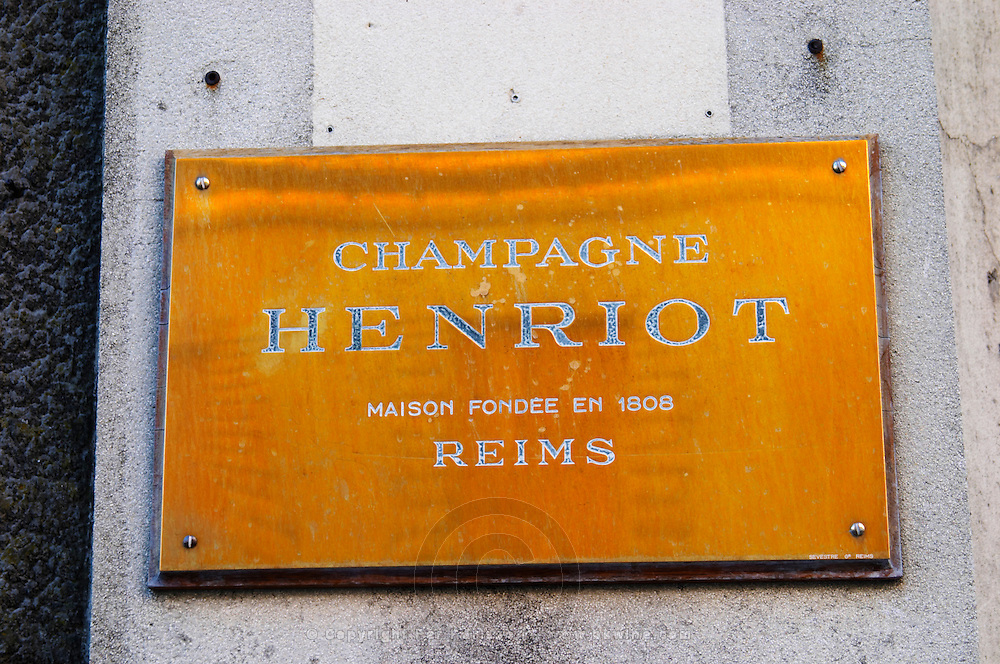 A polished brass sign: Champagne Henriot Champagne House Founded in 1808, Reims, Champagne, Marne, Ardennes, France