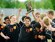 The Jackson Hole High School soccer team celebrates winning the 3A Wyoming State Soccer Championship on Saturday after besting Worland 4-0 in the final home match.
