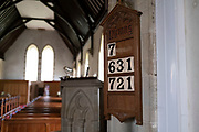 Hymn numbers at St Thomass Church on 16th August 2021 in St Dogmaels Pembrokeshire, Wales, United Kingdom. The church is in the grounds of the ruined St Dogmaels Abbey.