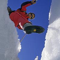 MOUNTAINEERING.  Michael Graber (MR) crosses crevasse on Palisade Glacier, John Muir Wilderness, Sierra Nevada, CA.