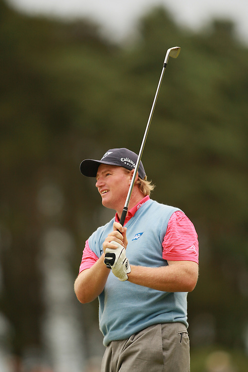 CARNOUSTIE, SCOTLAND - JULY 22:  Ernie Els follows through on an approach shot during the fourth round of the 136th Open Championship in Carnoustie, Scotland at Carnoustie Golf Links on Sunday, July 22, 2007. (Photo by Darren Carroll/Getty Images) *** LOCAL CAPTION *** Ernie Els