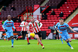 Oliver McBurnie of Sheffield United chases a ball in the box, pursued by Aaron Cresswell of West Ham United - Mandatory by-line: Nick Browning/JMP - 22/11/2020 - FOOTBALL - Bramall Lane - Sheffield, England - Sheffield United v West Ham United - Premier League