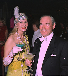 LORD & LADY CHETWODE at a party in London on 27th January 1998.MEW 35