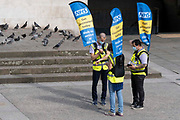 National Health Service NHS staff hand out information outside Marble Arch tube station, to encourage the public to go and get vaccinated at a nearby vaccination centre, on 11th August 2021, in London, England.