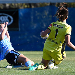 BRISBANE, AUSTRALIA - OCTOBER 30: Kyah Simon of Sydney has her shot on goal blocked by Brisbane Roar goalkeeper Mackenzie Arnold during the round 1 Westfield W-League match between the Brisbane Roar and Sydney FC at Spencer Park on November 5, 2016 in Brisbane, Australia. (Photo by Patrick Kearney/Brisbane Roar)