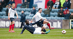 Dundee's Christian Nade and Falkirk's Mark Millar.<br /> Dundee 0 v 1 Falkirk, Scottish Championship game played today at Dundee's Dens Park.<br /> © Michael Schofield.