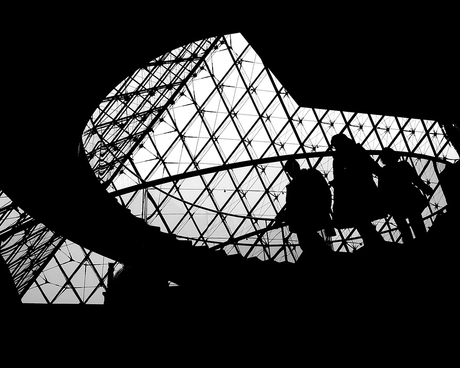 Visitors to the Louvre museum in Paris, enter through the pyramid designed by Chinese-American architect, I.M. Pei.