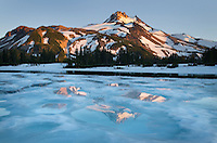 Mount Jefferson seen from ice covered Russell Lake in Jefferson Park, Mount Jefferson Wilderness, Oregon