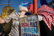 Anti Brexit pro Europe demonstrator dressed as an angel with wings at the protest in Westminster opposite Parliament as MPs debate and vote on amendments to the withdrawal agreement plans on 14th February 2019 in London, England, United Kingdom. Theres a special place in heaven for remainers who still love EU, reads her placard.