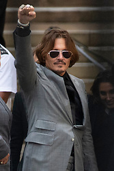 © Licensed to London News Pictures.<br /> 28/07/2020.  London, UK. American actor JOHNYY DEPP leaves the High Court in central London where he is in a legal dispute with UK tabloid newspaper The Sun over allegations he assaulted his former wife, Amber Heard. Photo credit: Marcin Nowak/LNP