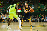 WACO, TX - MARCH 5: Nathan Adrian #11 of the West Virginia Mountaineers brings the ball up court against the Baylor Bears on March 5, 2016 at the Ferrell Center in Waco, Texas.  (Photo by Cooper Neill/Getty Images) *** Local Caption *** Nathan Adrian