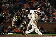 San Francisco Giants second baseman Joe Panik (12) swings at a Pittsburgh Pirates pitch at AT&T Park in San Francisco, California, on July 25, 2017. (Stan Olszewski/Special to S.F. Examiner)